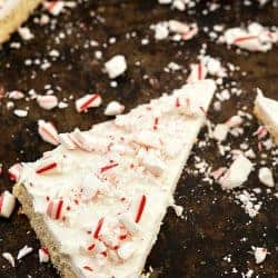 Frosted Peppermint Sugar Cookie Bars - Why do you need ppeppermint bark when you can have these incredibly easy sugar cookie bars? So moist with the creamiest frosting, then topped with chopped candy canes. Only one bowl is needed!