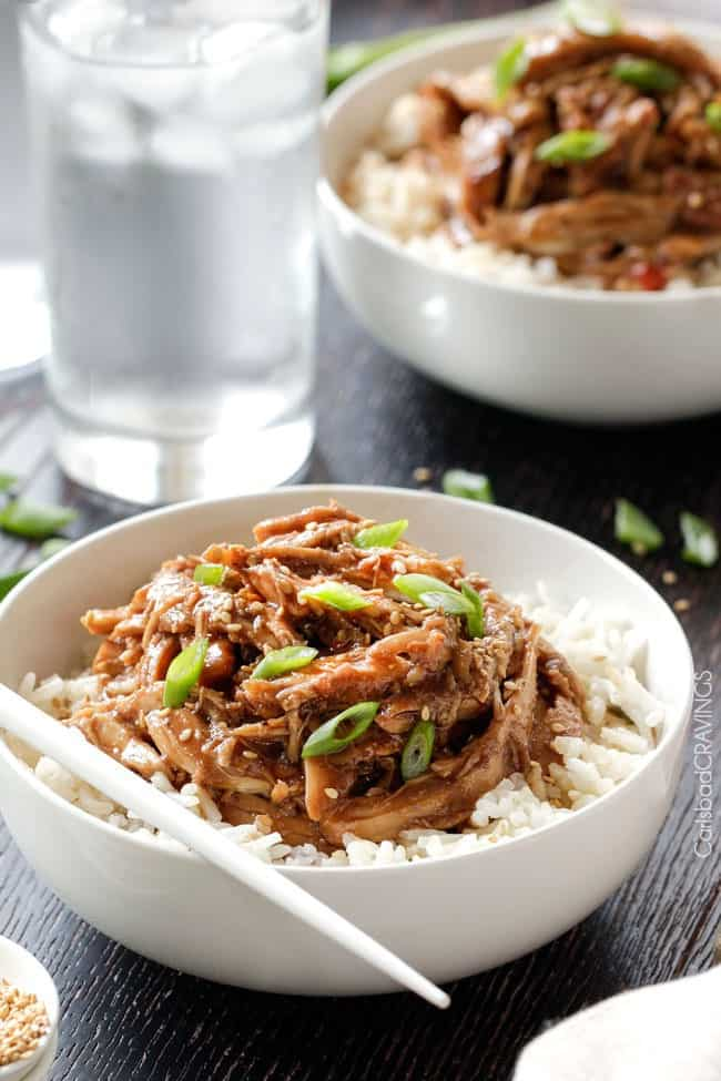 Honey Soy Chicken over rice in white bowl.