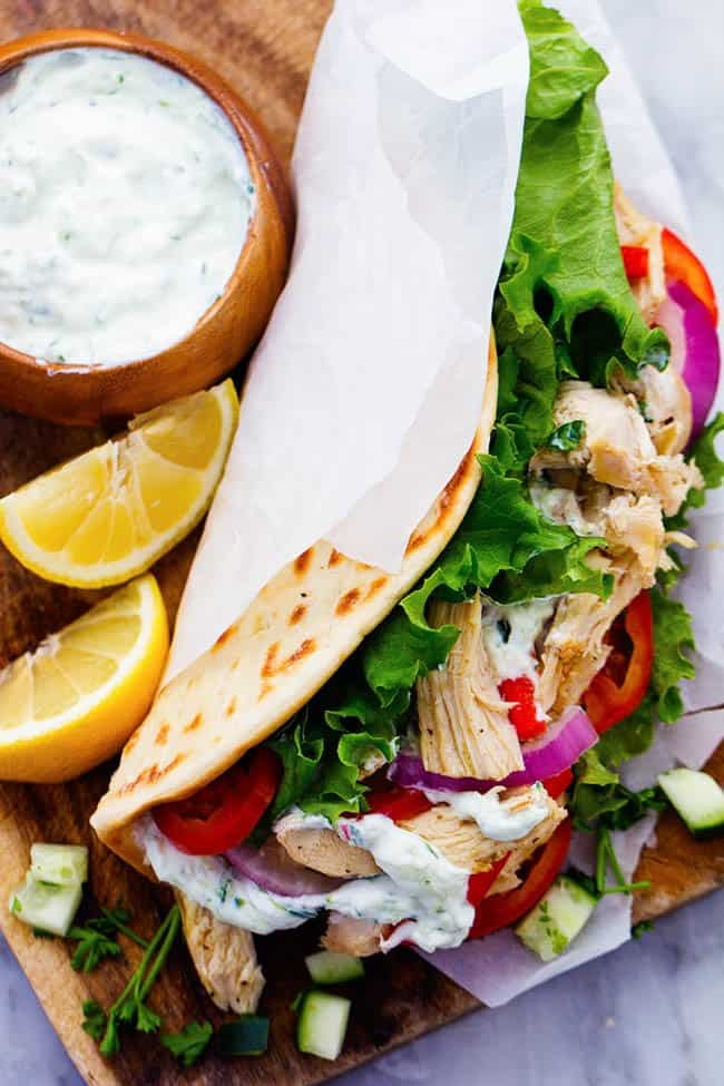 Slow Cooker Greek Chicken Gyros with Tzatziki seasoned chicken, tender vegetables and a classic cool cucumber sauce wrapped in a flat bread