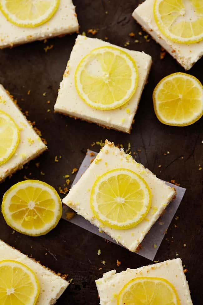 Lemon icebox bars with sliced lemons on top.