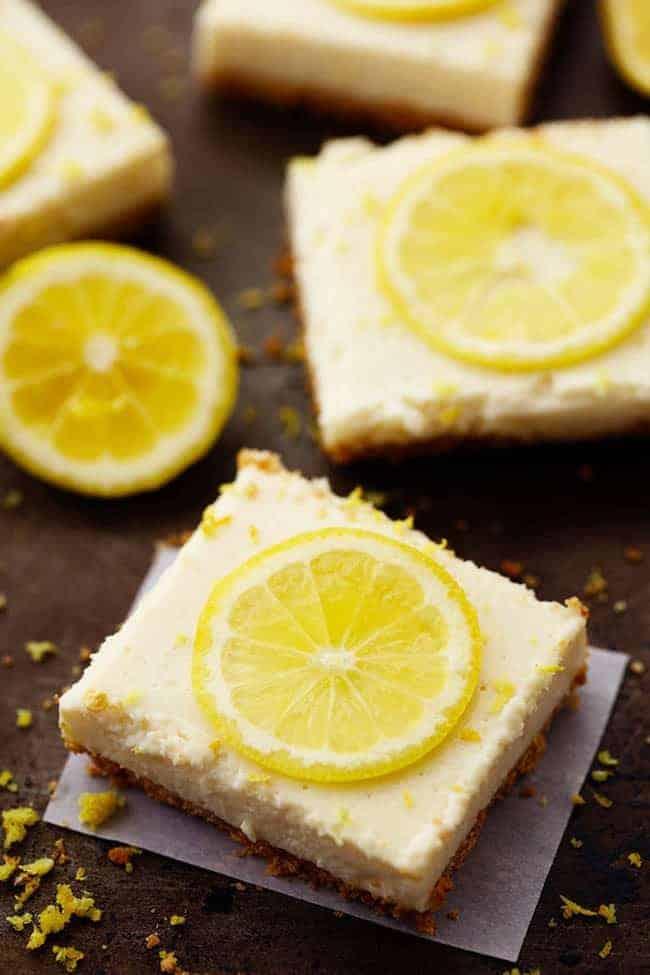 Lemon Icebox bars with lemon slice on top.