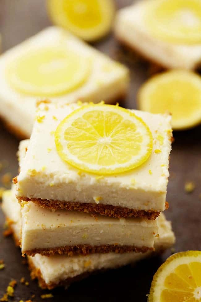 Lemon icebox bars with lemon slices on top.