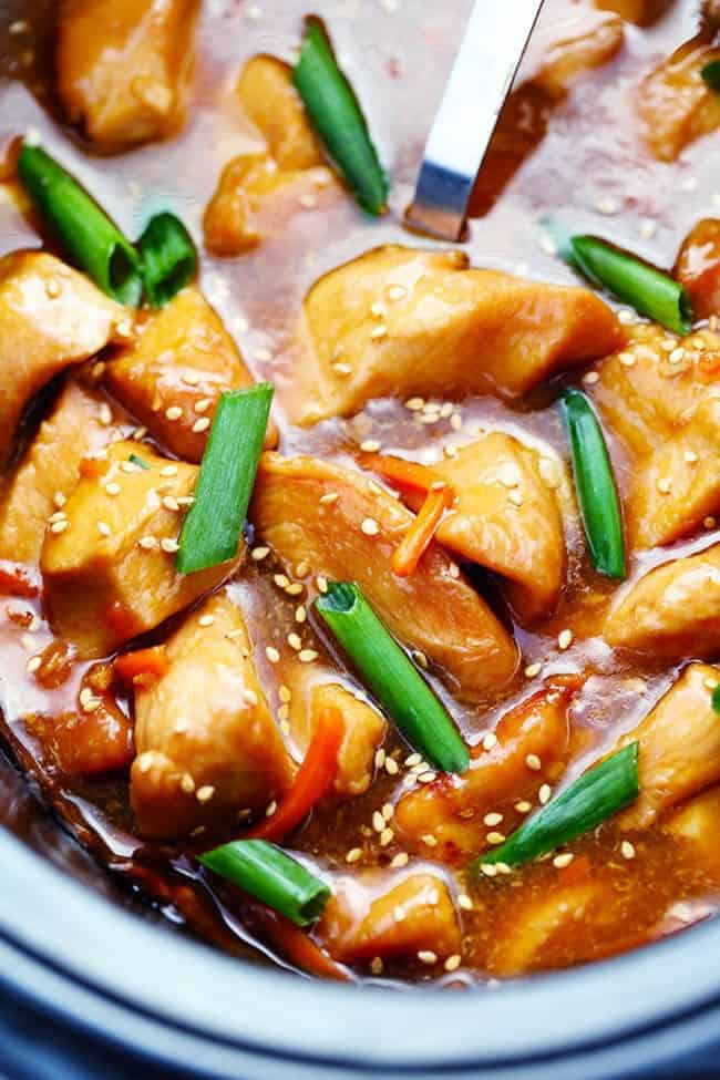 Mongolian chicken with green onions in a slow cooker.