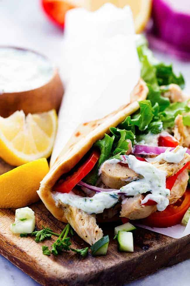 Slow Cooker Greek Chicken Gyros with Tzatziki seasoned chicken, tender vegetables and a classic cool cucumber sauce wrapped in a flat bread.