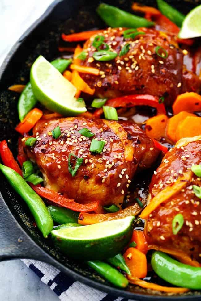 Thai Peanut Skillet Chicken with lime and other fresh vegetables.