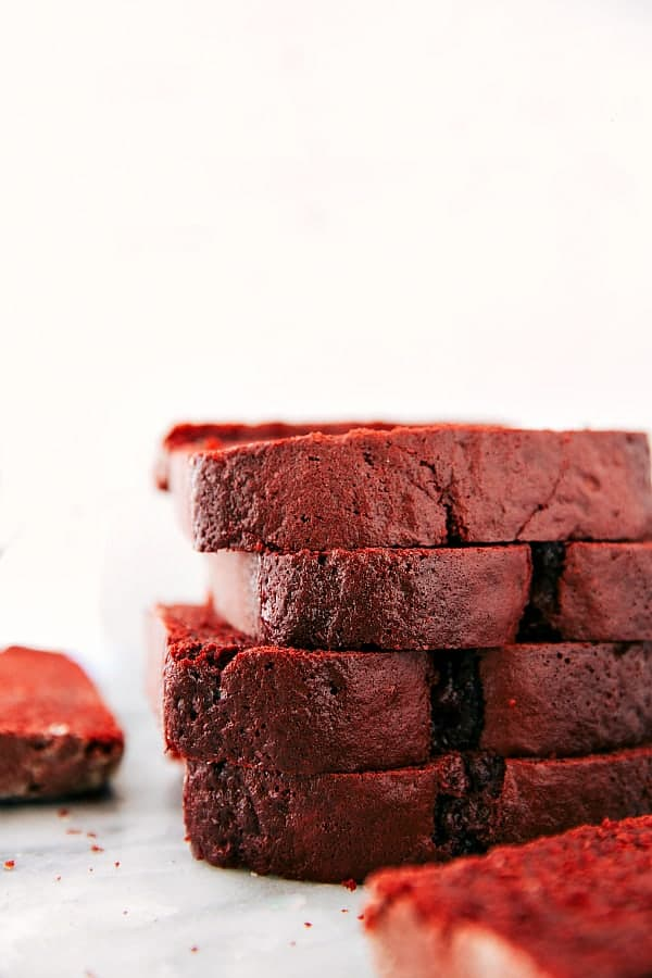 Slices of red velvet pound cake stacked on top of one another.