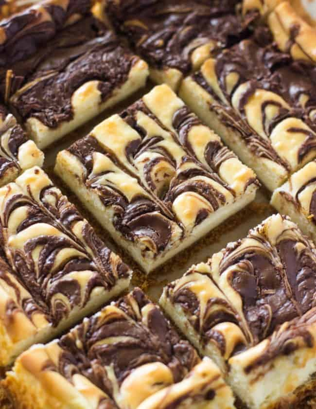 Nutella Swirl Cheesecake Bars sliced in 2 inch squares.