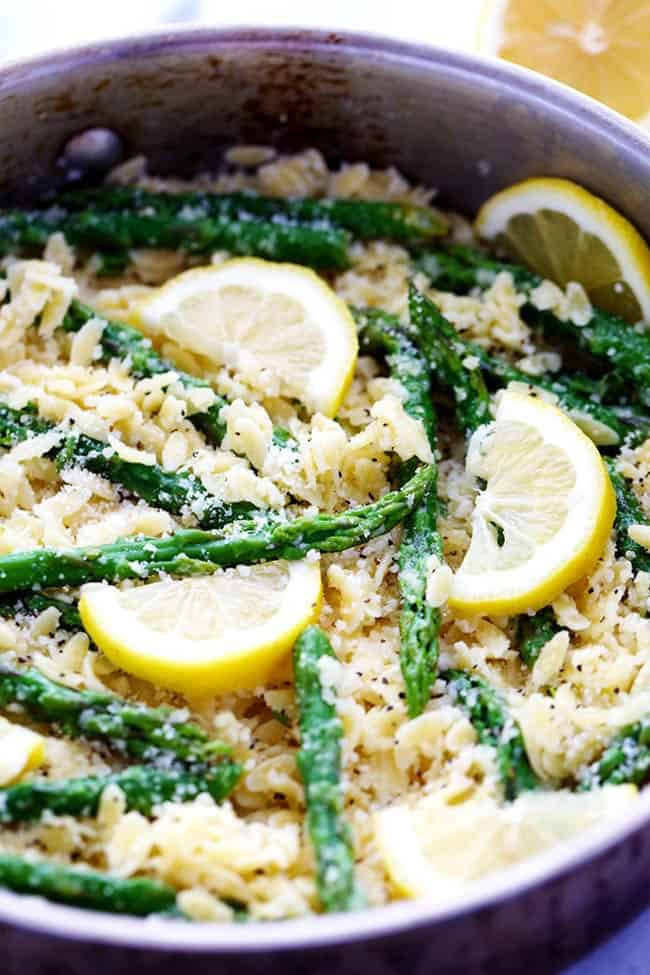 Lemon Parmesan Garlic Orzo with Asparagus in a large metal pot.