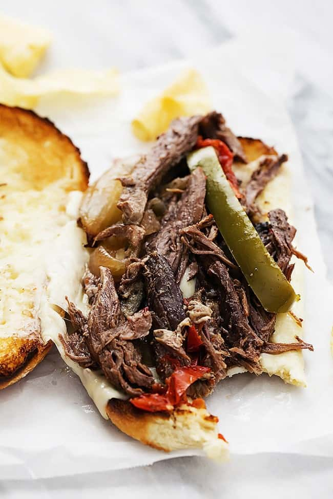 Slow cooker Philly cheesesteak on parchment paper.