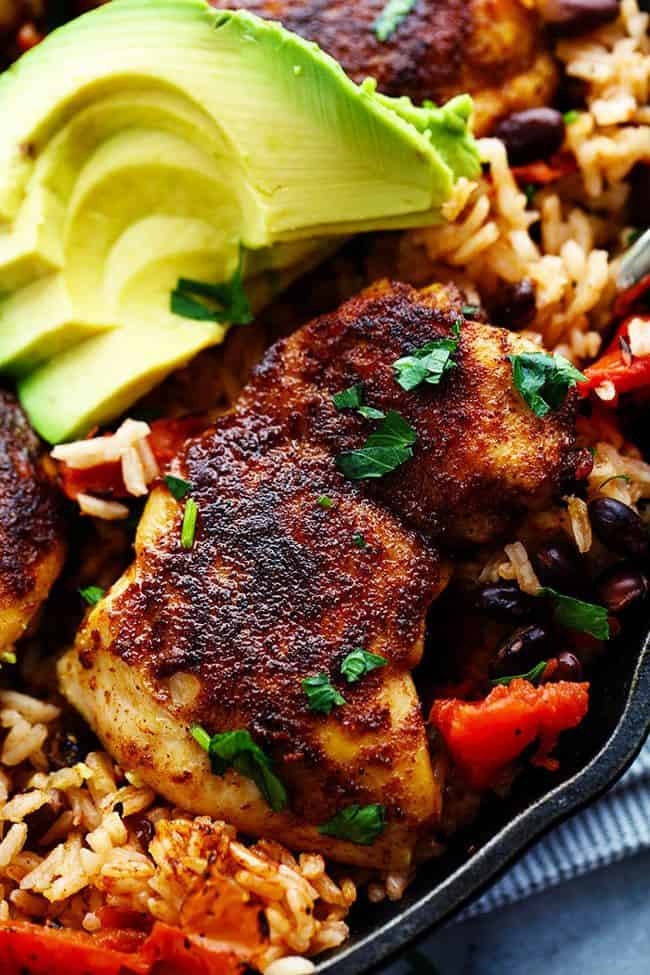 One Pan Southwest Blackened Cajun Chicken with Rice with fresh avocado on the side.
