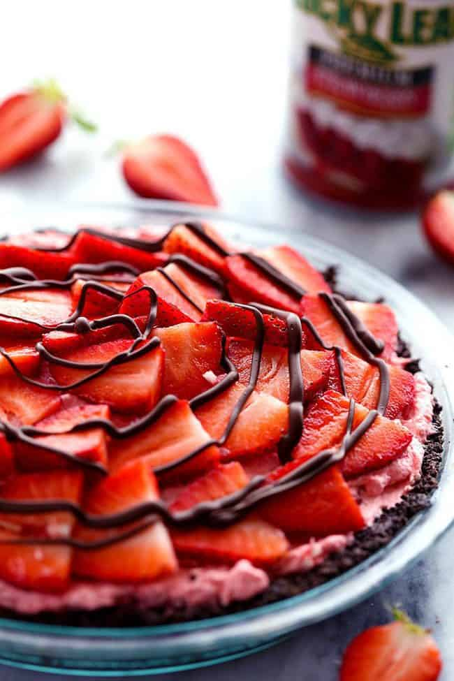 No Bake Chocolate Strawberries and Cream Pie in a clear pie dish.