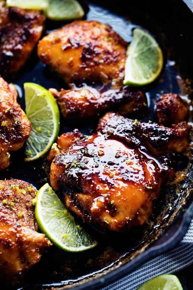 Skillet honey lime chicken in a large black skillet.