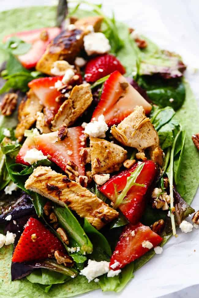 Strawberry Balsamic Chicken Salad placed on a tortilla to make a wrap.