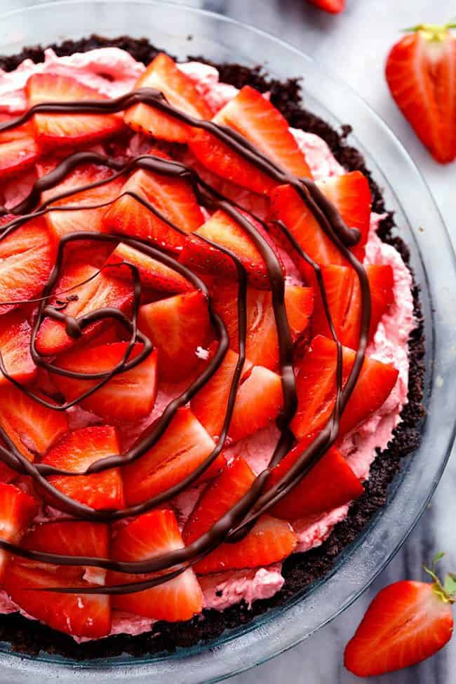 Overhead photo of No Bake Chocolate Strawberries and Cream Pie in a clear pie dish.