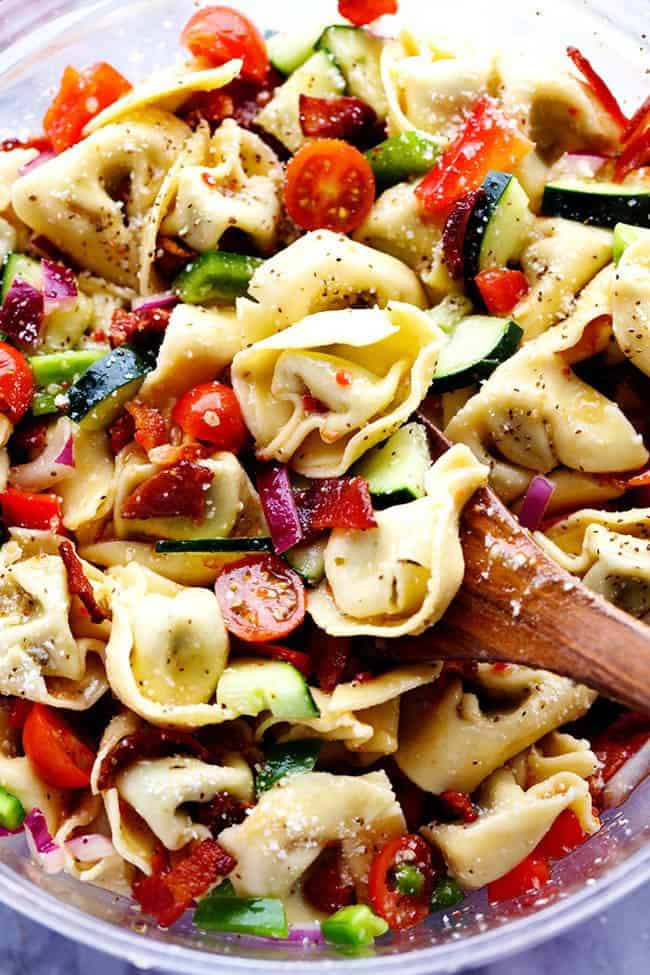 Zesty Tortellini Bacon Vegetable Salad in a clear bowl.
