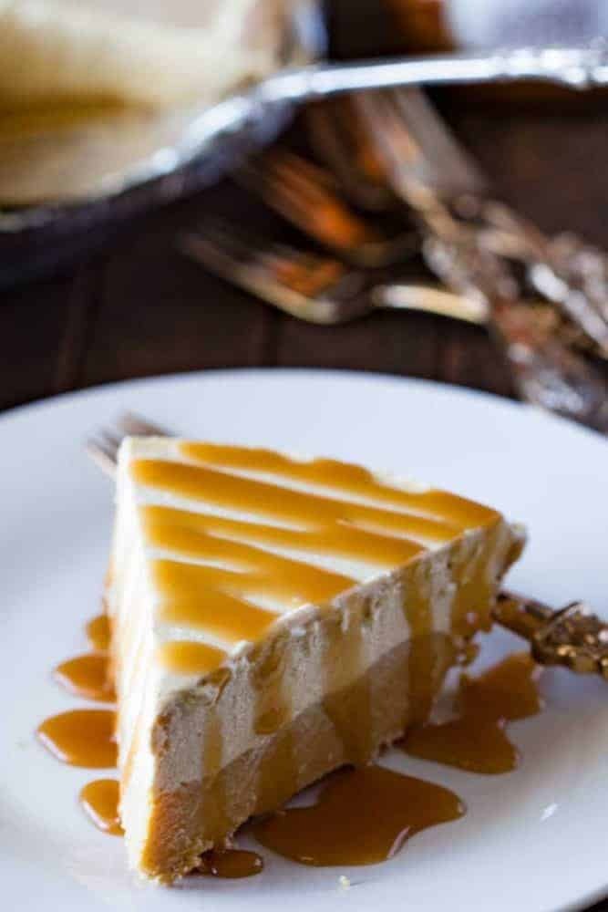 Cookie Butter Frozen Pie on a white plate with caramel drizzled on top.
