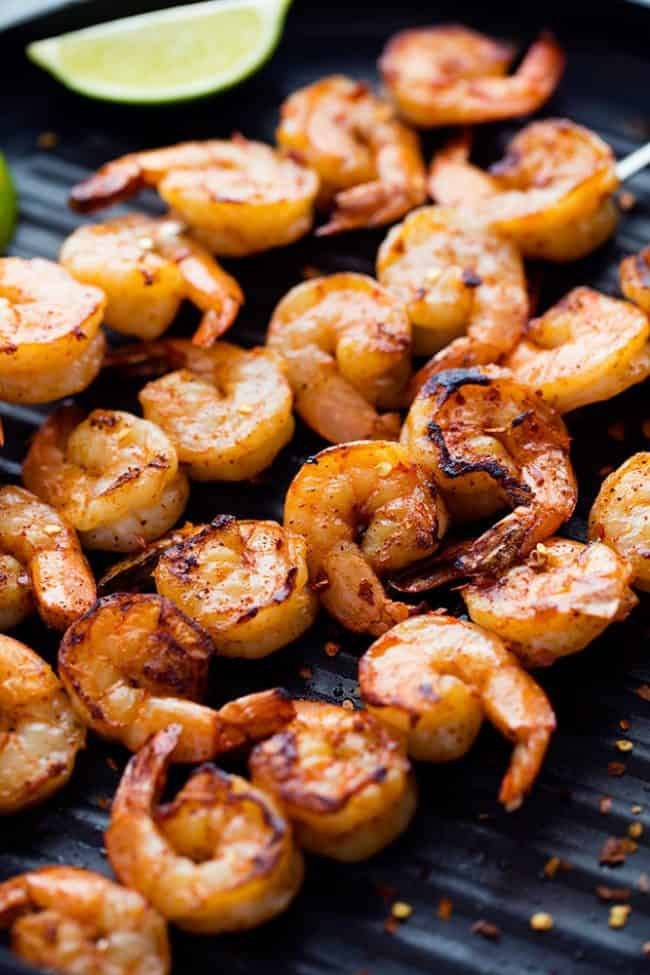 Grilled Spicy Lime Shrimp on a grill.