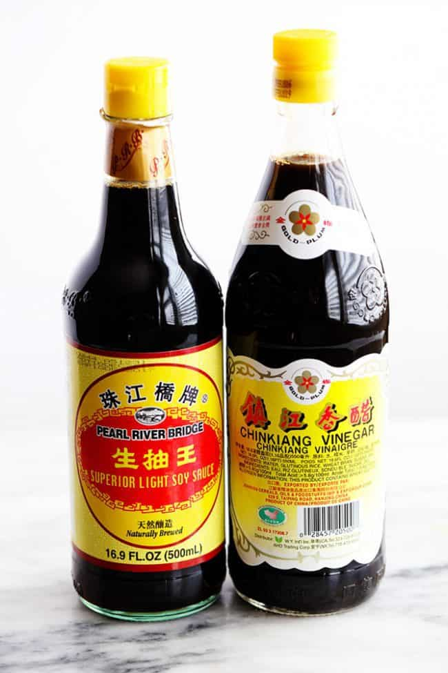 Two bottles of soy sauce.