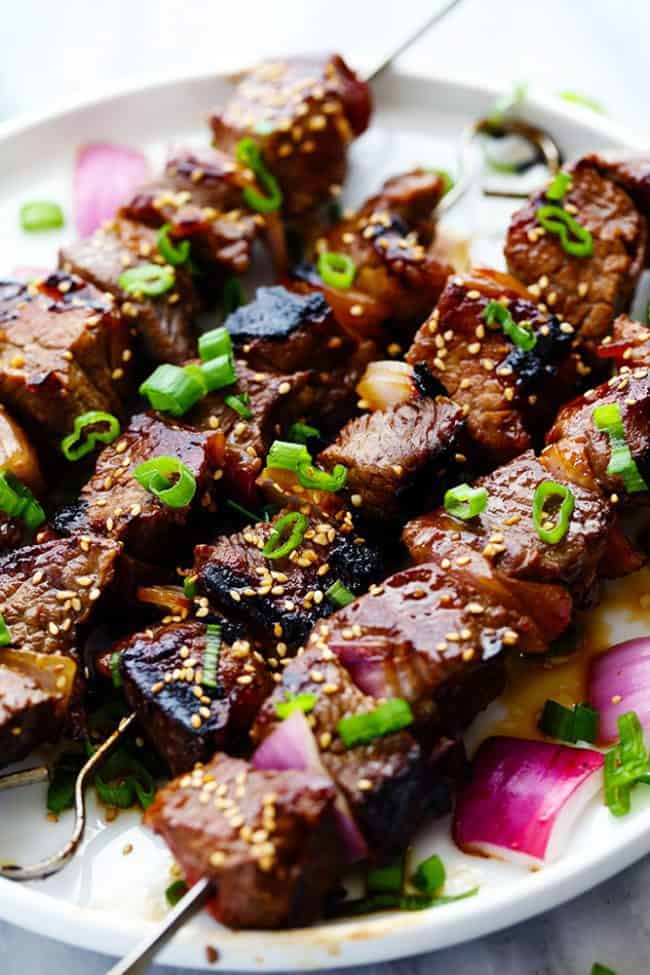 Grilled Asian Garlic Steak Skewers on a white plate.