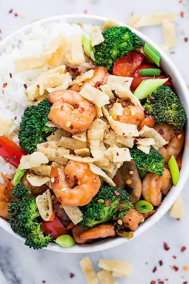 Wonton Shrimp Stirfry in a white bowl over white rice.