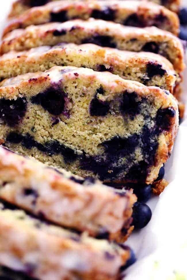 Blueberry Zucchini Bread with a Lemon Glaze that has been sliced.