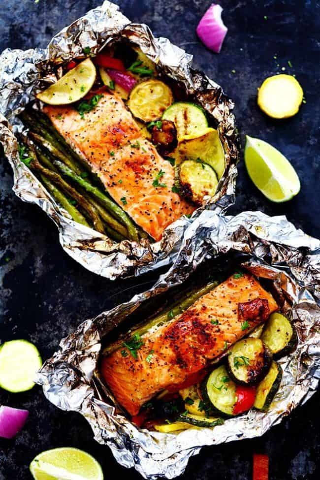 Lime Butter Salmon in Foil with Summer Veggies with the foil open to see the salmon.