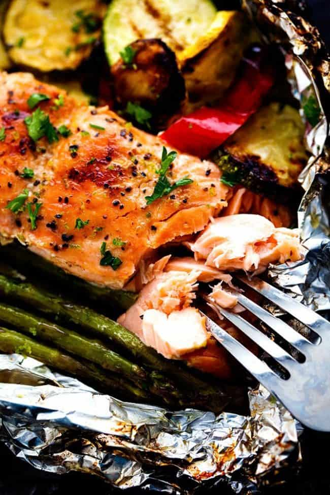Close up photo of Lime Butter Salmon with a metal fork removing some of the salmon.