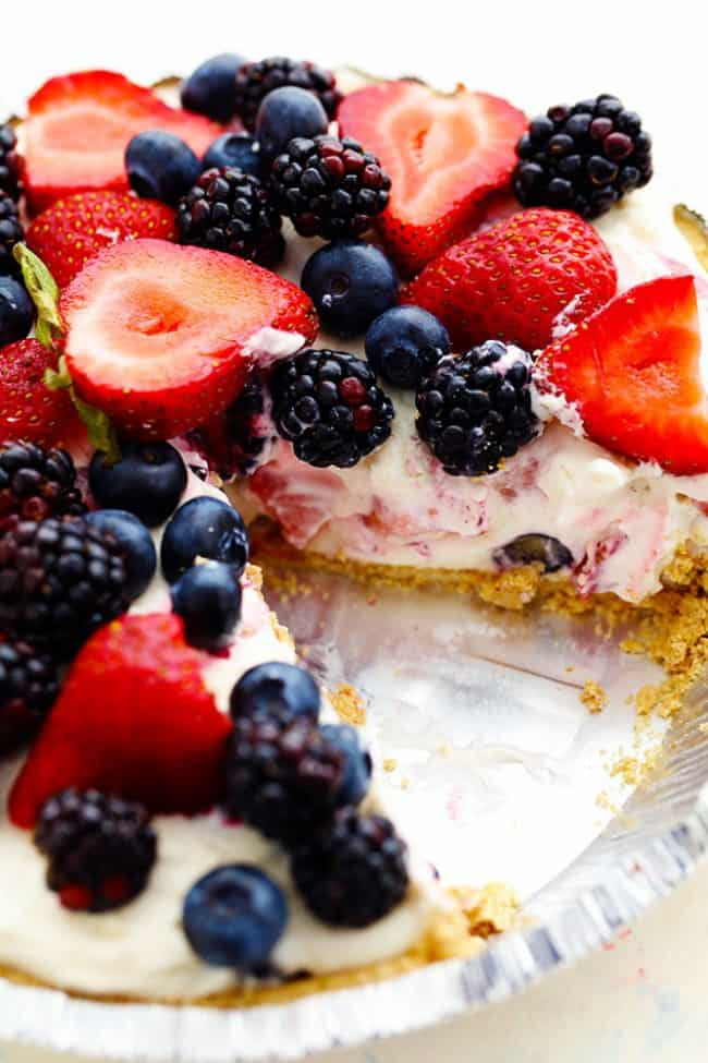 No Bake Very Berry Cheesecake in a pie tin with a slice removed.