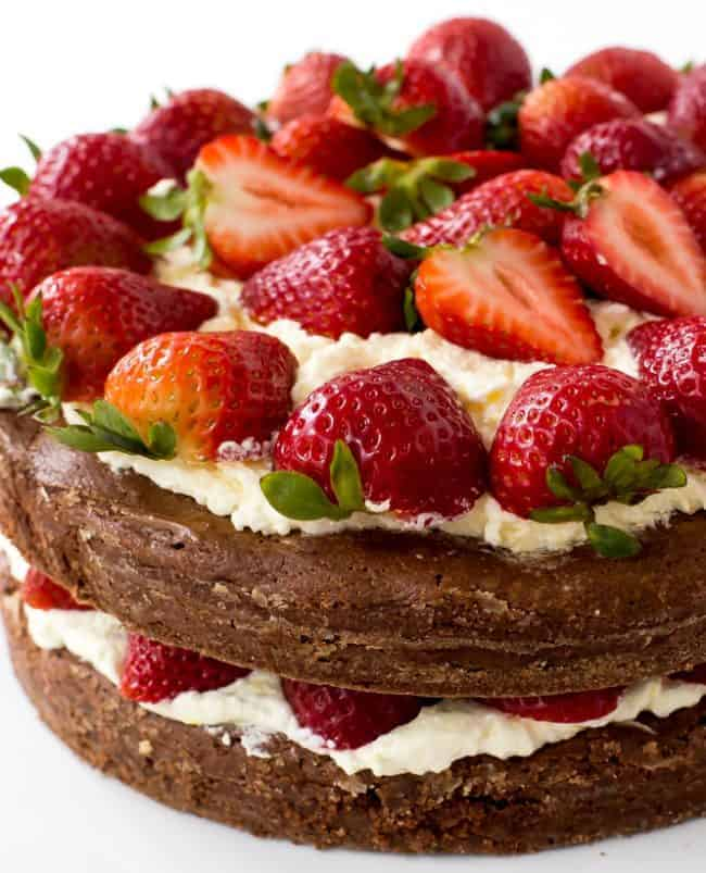 Brownie Strawberry Shortcake with fresh strawberries on the top and middle.