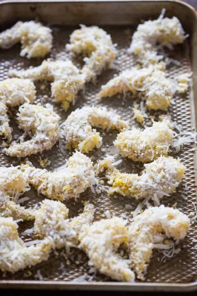 Easy Baked Coconut Shrimp on a baking sheet that has coconut coating on them.