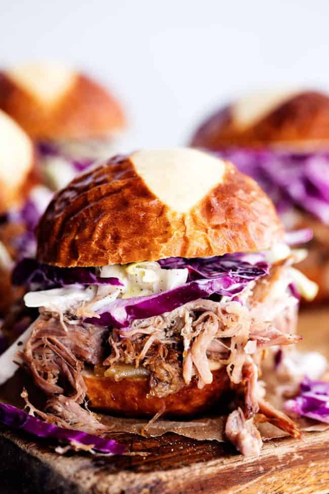 Sweet Carolina pulled pork sliders on a wooden board.