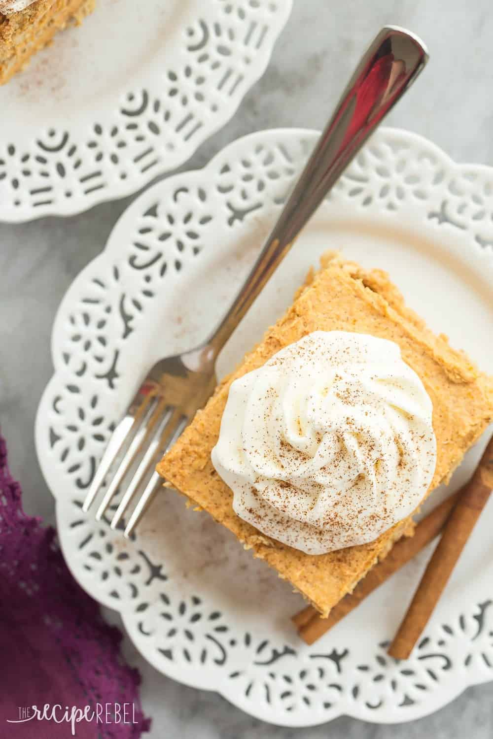Overhead photo ofPumpkin pie icebox cakeSpace on a white plate with a fork on the side.