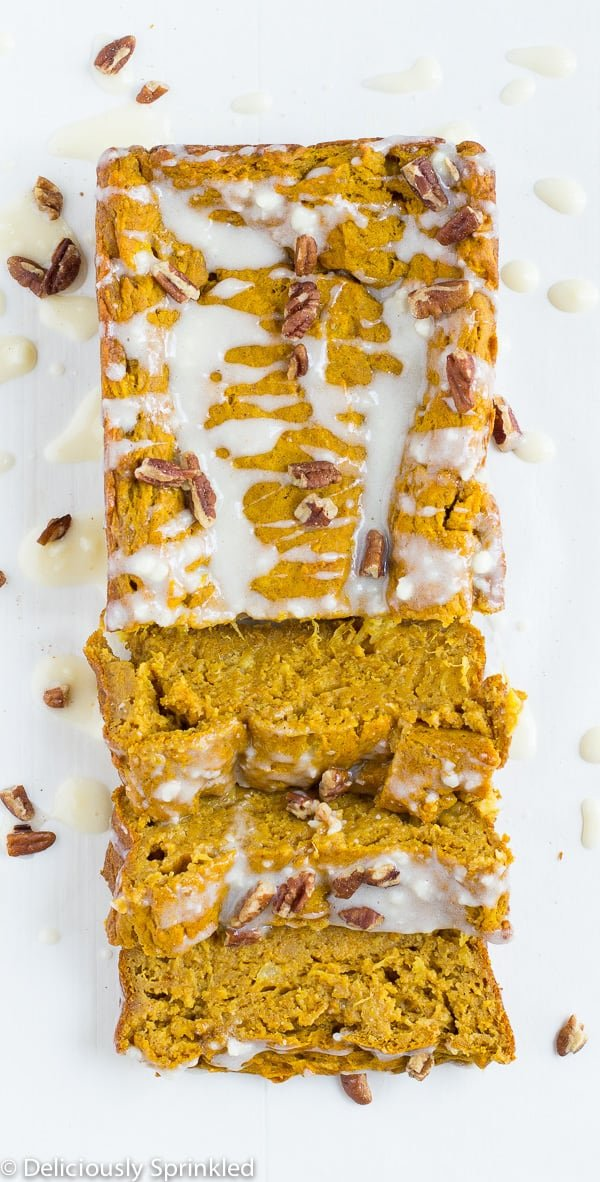 pumpkin sweet potato bread with three sliced pieces.