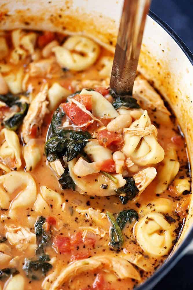 Creamy Tuscan Garlic Tortellini Soup in a large pot.