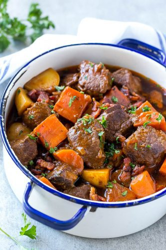 This beef stew is full of tender meat, colorful veggies and plenty of smoky bacon. A one pot meal that's perfect for cold weather!
