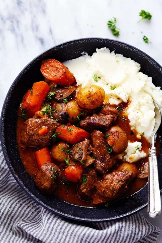 slow Cooker Beef Bourguignon with mashed potatoes on a plate
