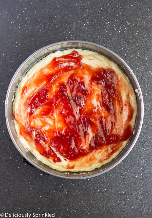Strawberry jam layered on top of a buttery cake.