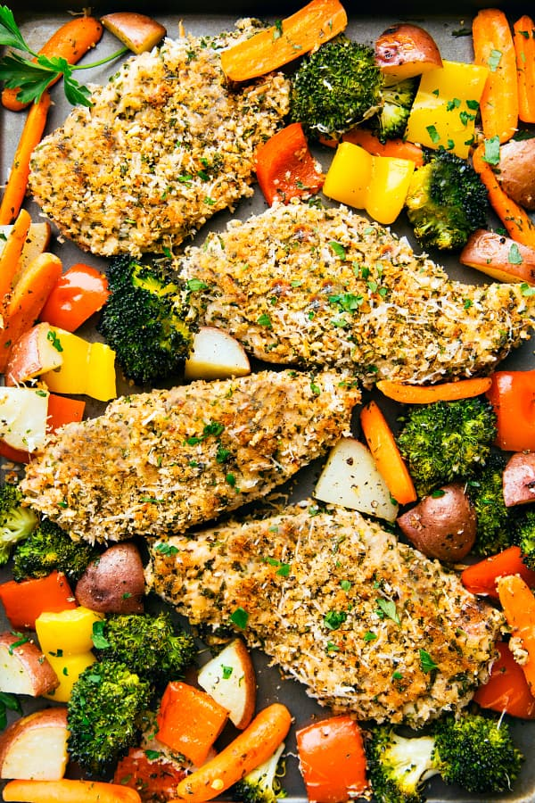 One Pan Crispy Walnut Herb Chicken and Vegetables on a baking tray.