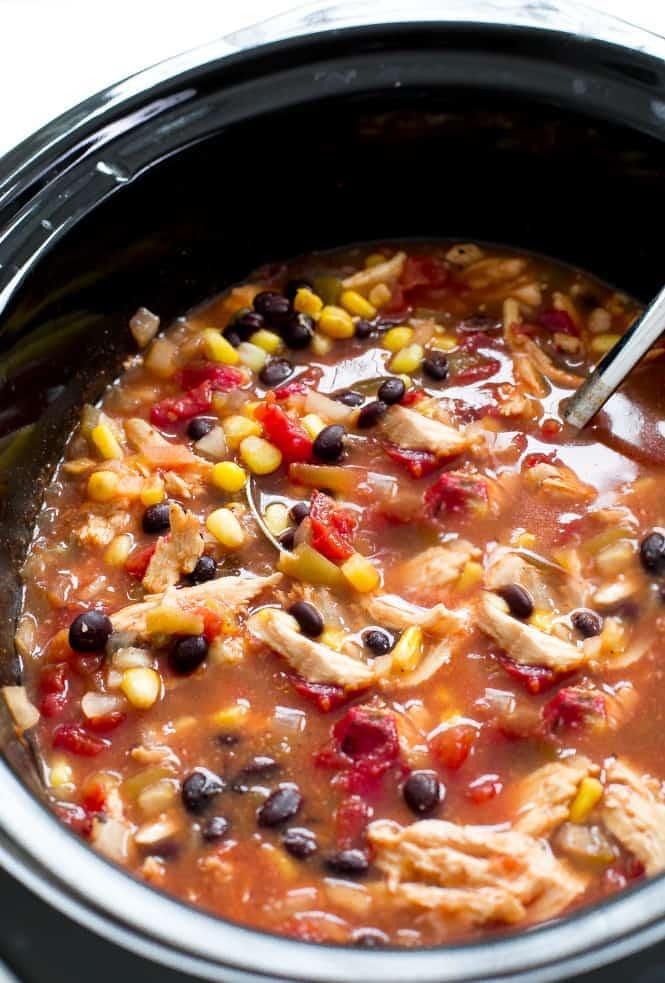 Slow Cooker Enchilada Soup in a black crock pot.