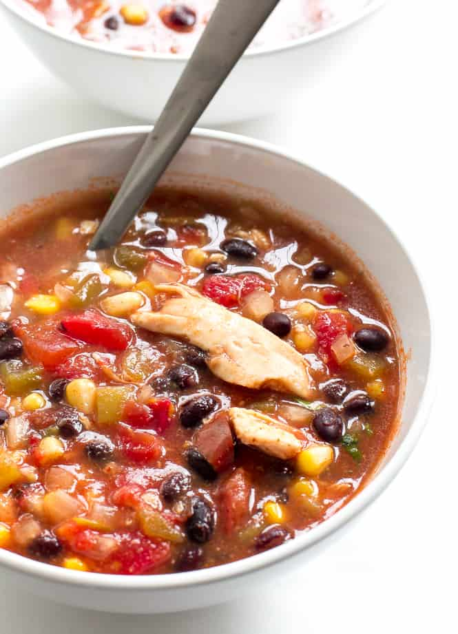 Slow Cooker Enchilada Soup in a white bowl.