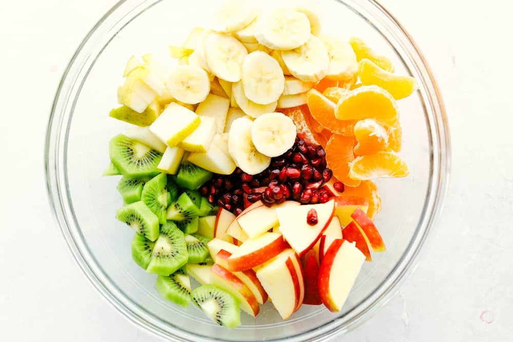 Winter Fruit Salad with bananas apples, oranges kiwi and pomegranates.
