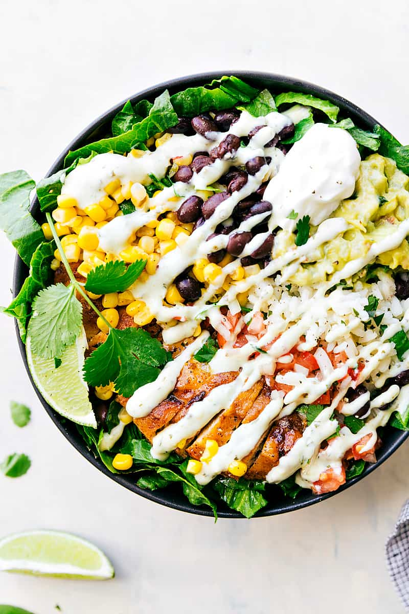 Finished Chicken Burrito Bowl drizzled with dressing.