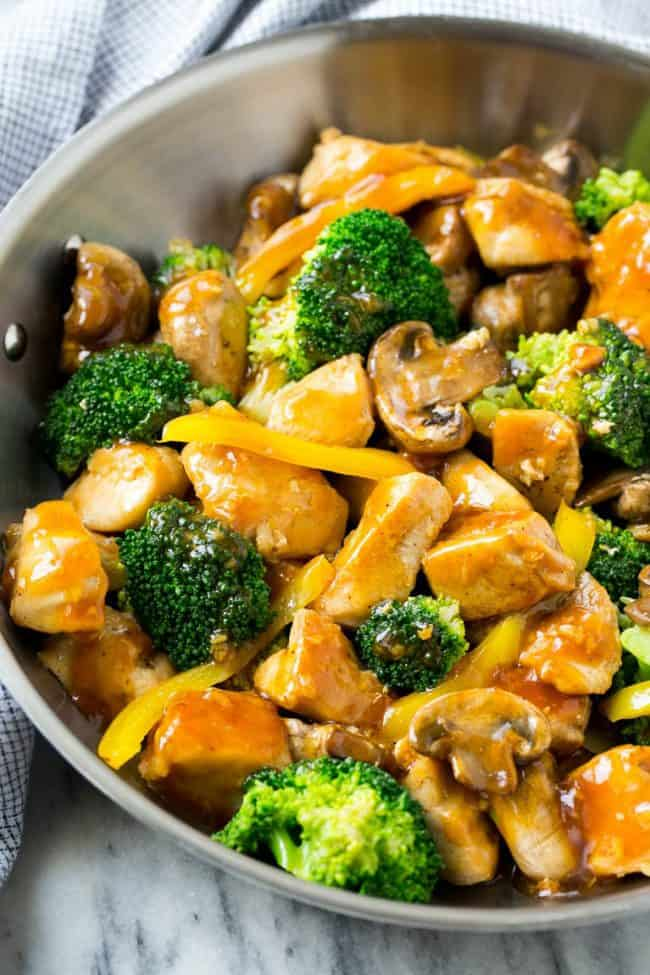This garlic chicken stir fry is a quick and easy dinner that's perfect for those busy weeknights! Cubes of chicken are cooked with colorful veggies and tossed in a flavorful garlic sauce for a meal that's way better than take out!