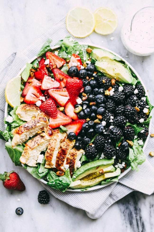 Finished Triple Berry Chicken Avocado Salad with a Creamy Lemon Poppyseed Dressing in a bowl.