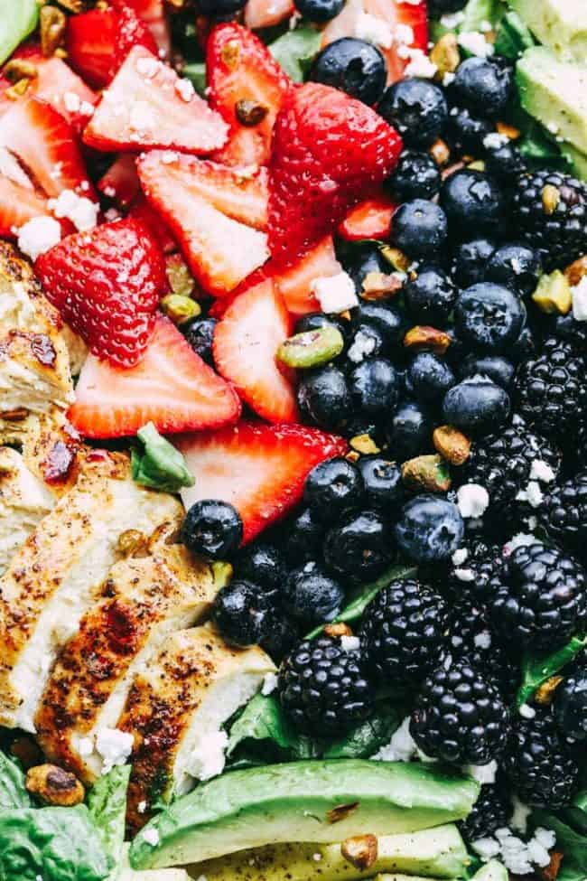 Triple Berry Chicken Avocado Salad with close up on strawberries, blueberries, blackberries and chicken.