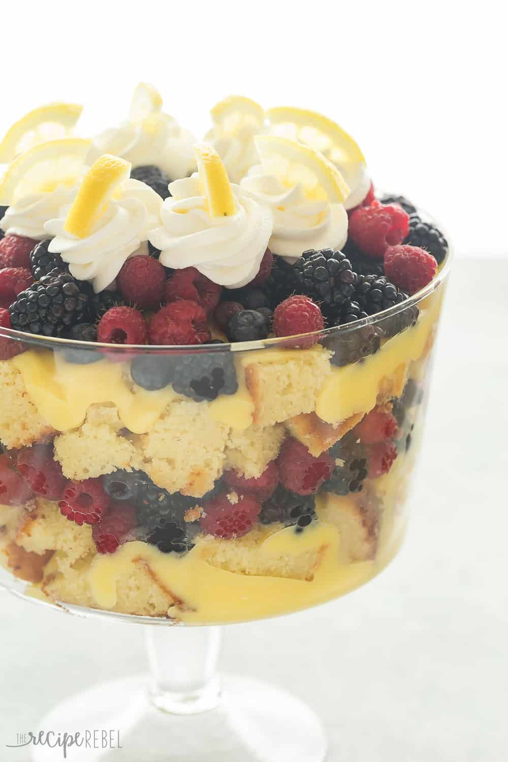 This Lemon Berry Trifle is perfectly tart and sweet, with a citrusy lemon cake, vanilla pudding, whipped cream and a load of berries! It's the perfect dessert for Easter or Spring.
