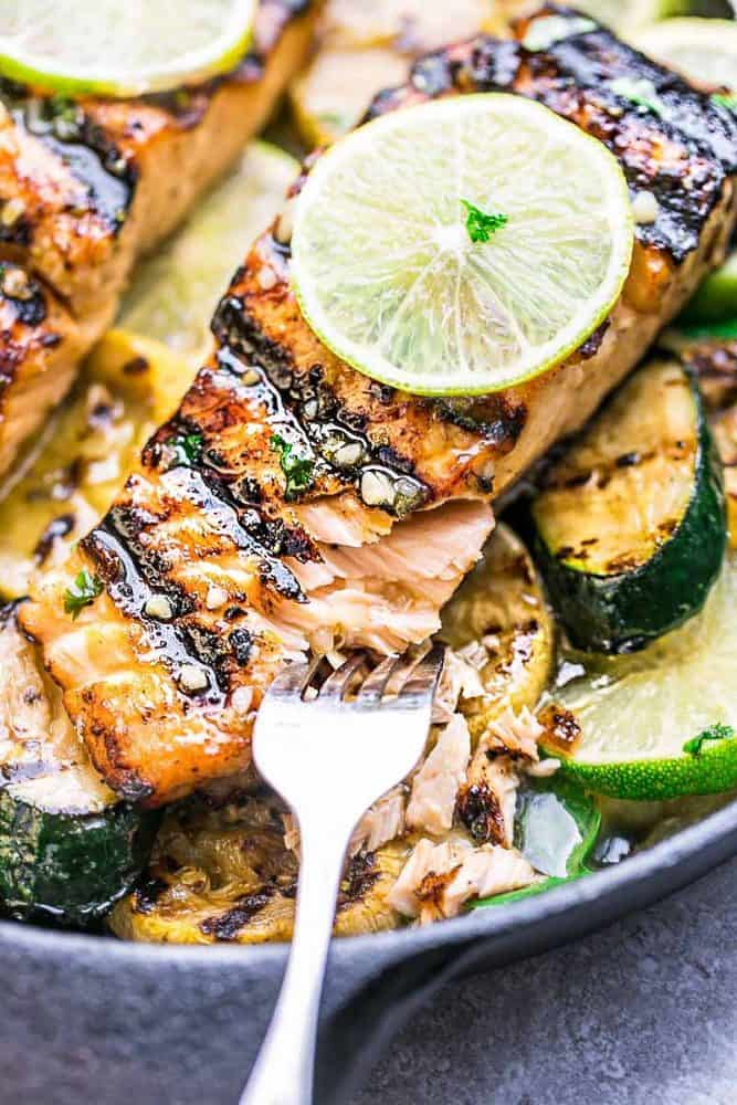 This Grilled Honey Lime Salmon being pulled apart with a fork.