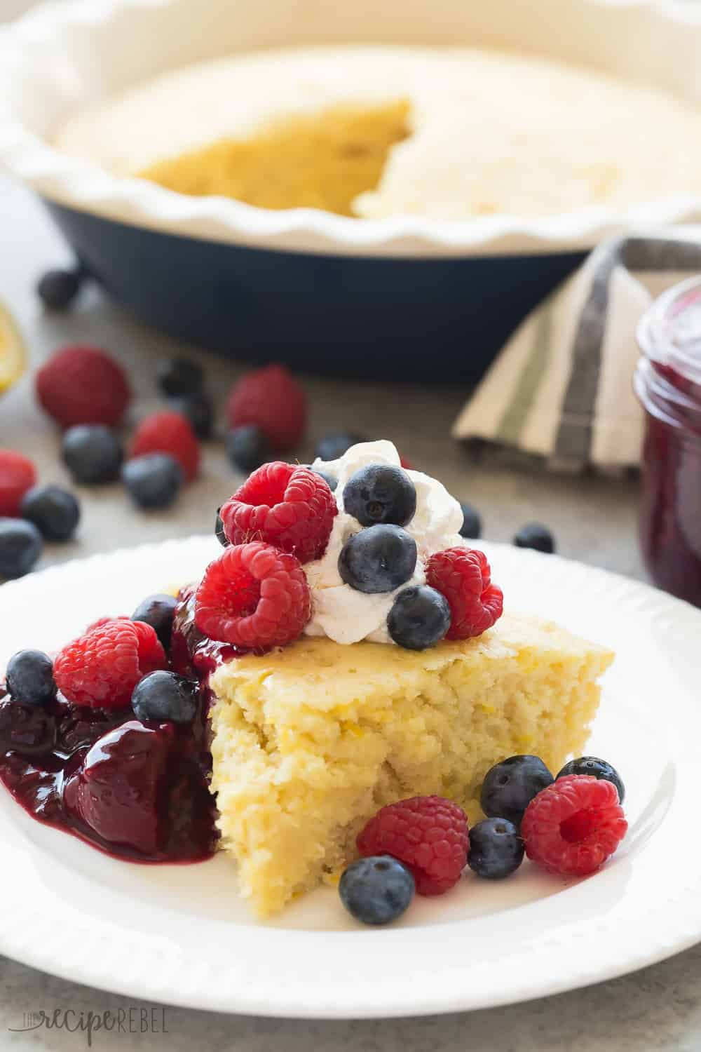 This Lemon Baked Pancake with Berry Sauce is such an easy breakfast for serving a crowd! Perfect for all your holiday brunches.