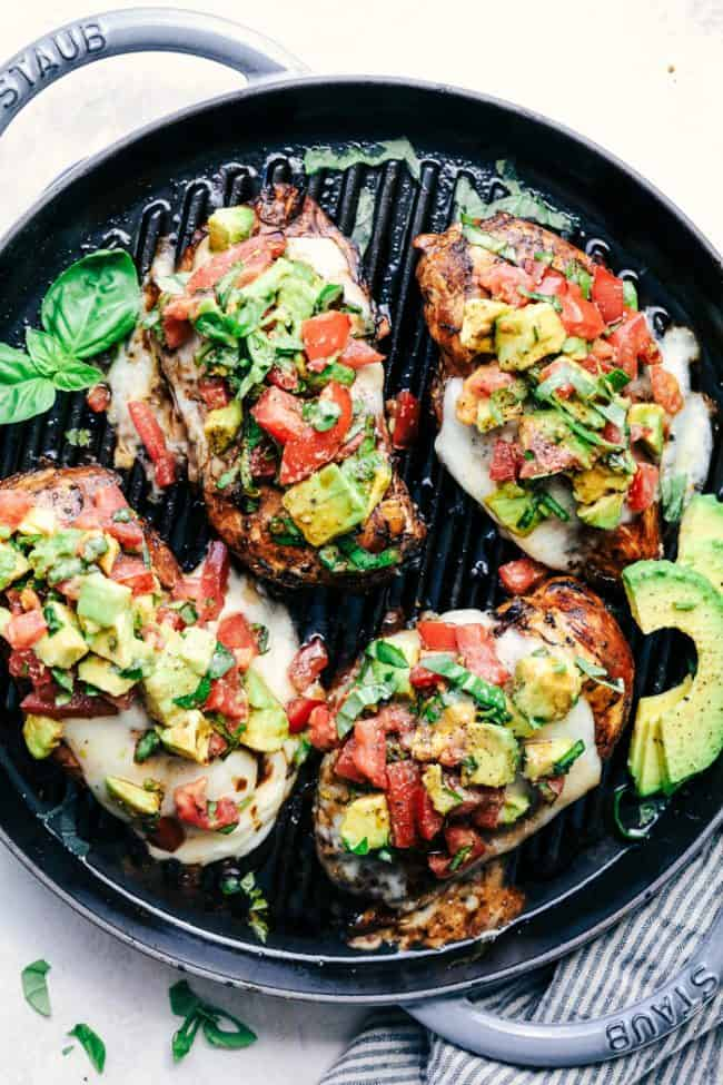Grilled California Avocado Chicken in a black skillet.
