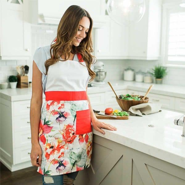 Bloom in your kitchen with our Coral Floral Apron.
